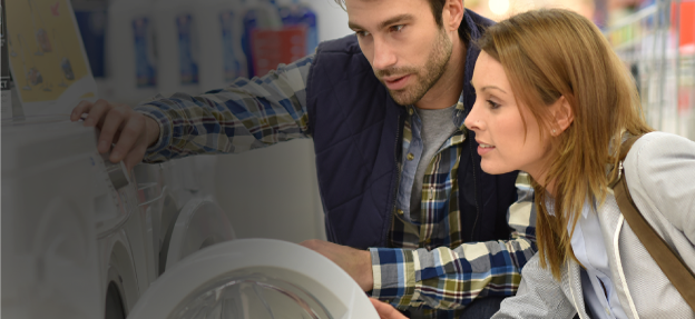 Couple looking at washing machine